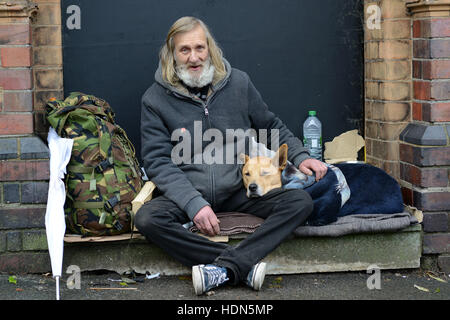 A homeless man and his canine companion living rough on the streets of Birmingham. The pair have been together 10 - Stock Photo