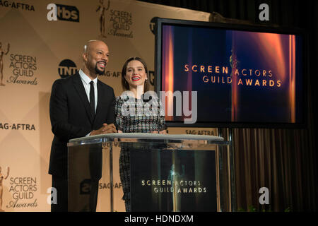 Los Angeles, California, USA. 14th Dec, 2016. U.S. singer Common (L) and actress Sophia Bush speak onstage during - Stock Photo