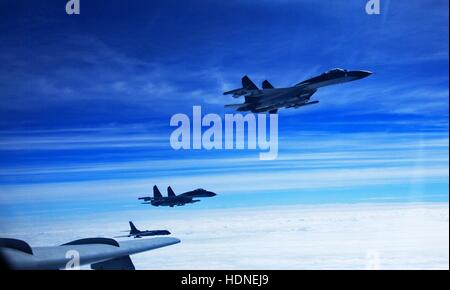 Beijing, China. 15th Dec, 2016. File photo shows Chinese Air Force aircrafts taking part in a high sea drill. Recent - Stock Photo