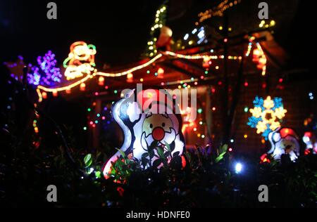 A view of a house in Westfield, East Sussex, as residents of the village decorate their houses in Christmas lights - Stock Photo