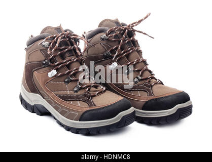 Pair of new hiking boots isolated on white background - Stock Photo