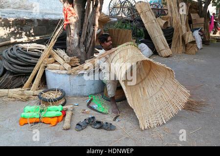 Bamboo mudda stool and chair makers in Anna Sagar Ghati Ganj , Ajmer, Rajasthan, India - Stock Photo