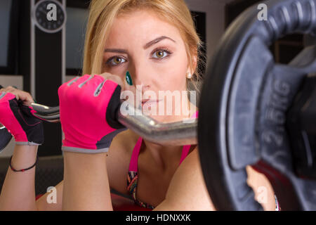 Sports workout in gym, blond girl training in gym - Stock Photo