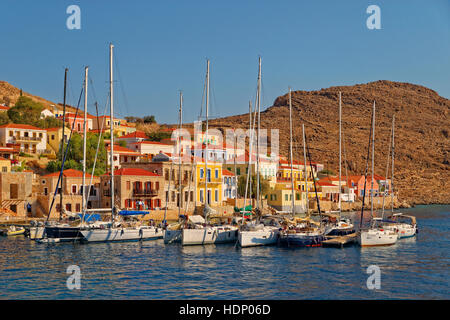 Yacht berths at Chalki town, Greek island of Chalki situated off the north coast of Rhodes, Dodecanese Island group, - Stock Photo
