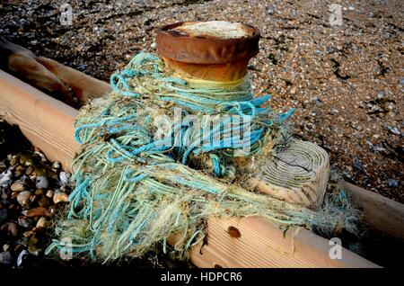 AJAXNETPHOTO. 2013. WORTHING, ENGLAND. - SEA POLLUTION - POLYETHELENE ROPE AND FINE MESH NYLON FISHING NETS WRAPPED - Stock Photo
