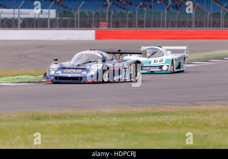 Frank Lyons in a 1989, Ald C289 leads Trevor Reeves in an Emka 84C competing in the Group C race at the 2016 Silverstone - Stock Photo
