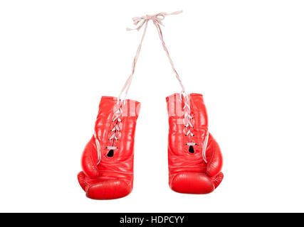 old used and battered red leather boxing gloves isolated on white background - Stock Photo