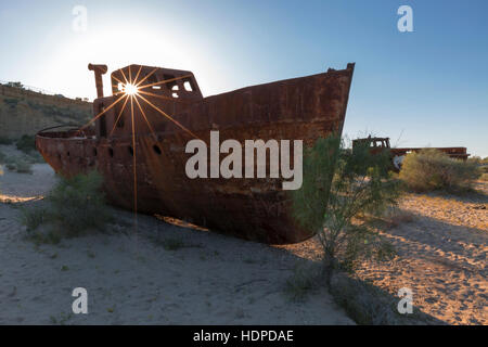 Old ship that rested on the bottom of the Aral Sea after its waters started drying out, in Uzbekistan. - Stock Photo