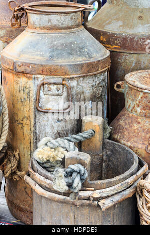 Period milk churns and buckets at a Victorian themed festival in Granary Square, King's Cross, London, UK - Stock Photo