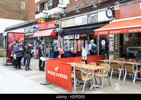 Queue of people waiting in line at the start of Record Store Day 2016 at Flashback Records, Essex Road, London, - Stock Photo