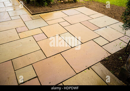 New paving slabs in position awaiting grouting - Stock Photo