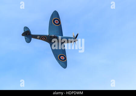 Vintage Supermarine Spitfire aircraft displaying to the onlookers at the Southport airshow - Stock Photo