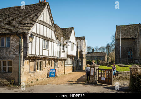 Old houses opposite the church in Lacock Wiltshire UK - Stock Photo