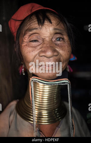 Portrait of a Kayan woman wearing the traditional brass neck rings, Loikaw, Myanmar. - Stock Photo