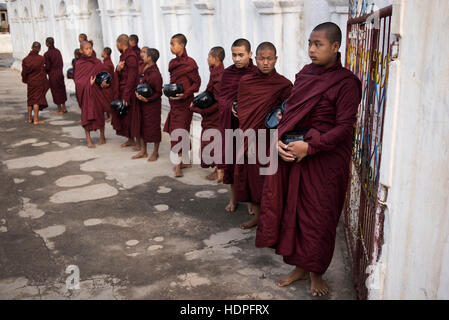 A group of young Buddhist monks prepared to go the morning food alms collection,  Shwe Yan Pyay Monastery, Nyaungshwe, - Stock Photo