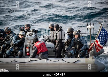 U.S. sailors from the visit, board, search and seizure team ride a rigid-hull inflatable boat during a training - Stock Photo