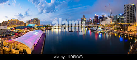 Iconic Sydney Darling Harbour purple night lights reflexion - Stock Photo