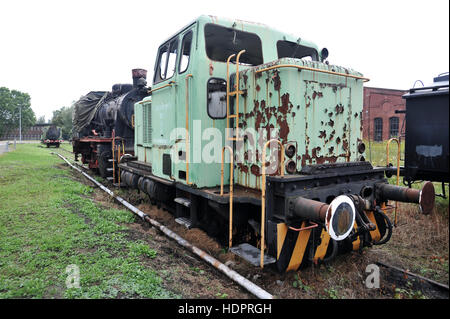 Abandoned and derelict diesel shunting engine in a German rail yard, urban exploration - Stock Photo