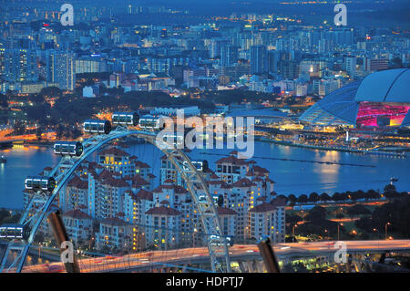 Aerial view of the Singapore Flyer at night - Stock Photo