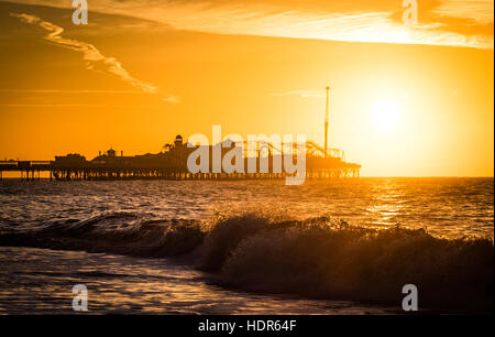 Sunrise over Palace Pier Brighton - Stock Photo