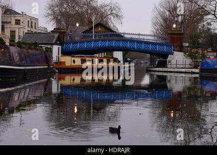 Waterside café barge, bridge and moored barges in Regents Canal Maida Vale, London United Kingdom - Stock Photo