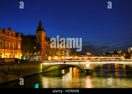 The Conciergerie building in Paris, France in the night - Stock Photo
