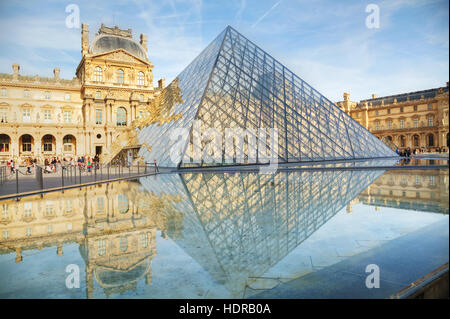 PARIS - NOVEMBER 1: The Louvre Pyramid on November 1, 2014 in Paris, France. It serves as the main entrance to the - Stock Photo