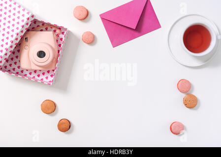 Flat lay of a box with photo camera in it - Stock Photo