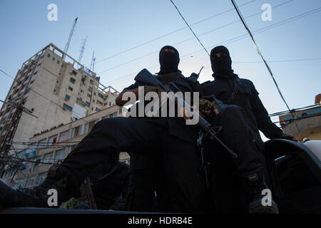 Fighters from the Al-Qassam brigade, the military wing of Hamas organisation, at a celebration of their 48th anniversary. - Stock Photo