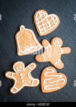 Christmas gingerbread cookies on a dark background. - Stock Photo