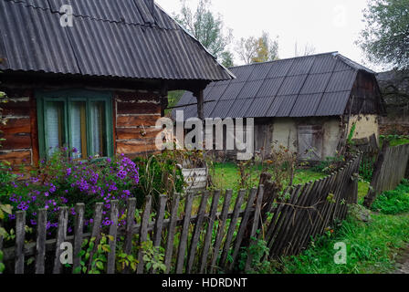 Wooden houses maramures romania stock photo royalty free image 58668994 alamy - Houses maramures wood ...