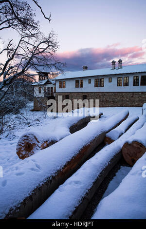 Wood pile covered with snow - Stock Photo