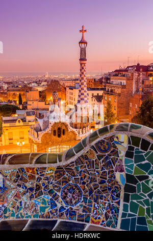 Park Guell with city skyline behind at sunset, Barcelona, Catalonia, Spain - Stock Photo