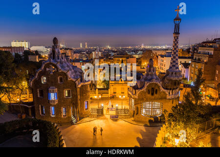 Night view of Park Guell with city skyline behind, Barcelona, Catalonia, Spain - Stock Photo