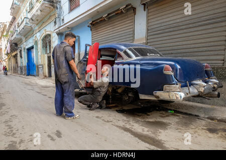 Car repairs on the street in La Havana, Cuba. - Stock Photo