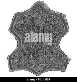 Genuine all leather upper label printed text icon tag, gray grained suede texture, large detailed isolated textured - Stock Photo