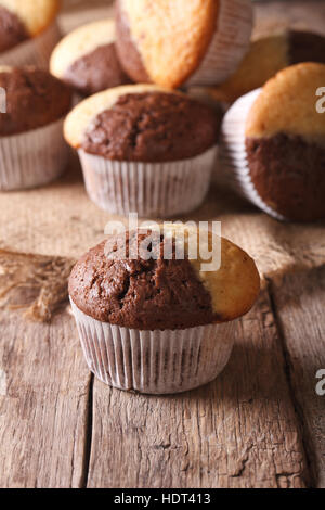 beautiful two-tone chocolate muffins on a table close-up, vertical - Stock Photo