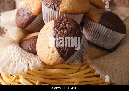 Delicious chocolate orange muffins in a basket close-up, horizontal - Stock Photo