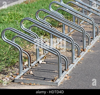 Bicycle storage on the street side in the city - Stock Photo