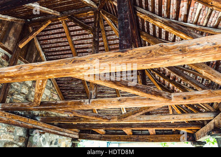 Interior framework of stone and wooden building as seen from a low angle view - Stock Photo