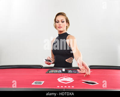 Woman playing blackjack, casino, playing cards, chips - Stock Photo