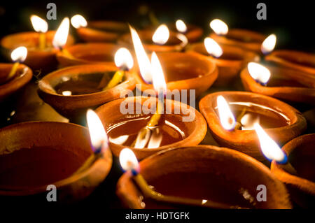 Shots of earthenware lamps filled with oil and with a cotton wick. These diyas are lit during diwali and other celebrations - Stock Photo