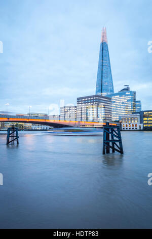 London skyline at dusk with London Bridge and The Shard in view over the River Thames - Stock Photo
