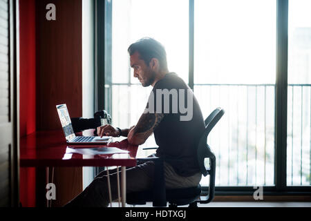 ... Man Busy Photographer Editing Home Office Concept   Stock Photo