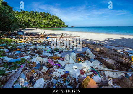 Polluted beach with rubbish in national park of Thailand - Stock Photo
