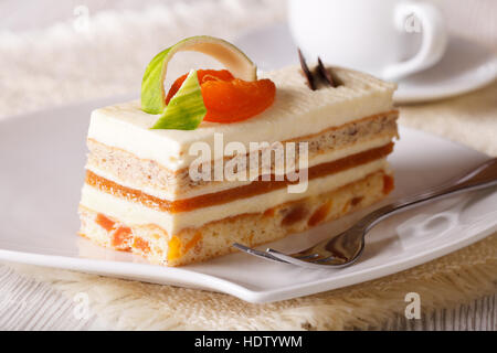 Slice of apricot cake on a plate. horizontal - Stock Photo