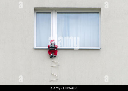 Santa Claus Climbing Outside Of Building In Paris France