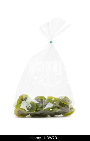 kiwi dried fruit isolated on white background with plastic wrap - Stock Photo