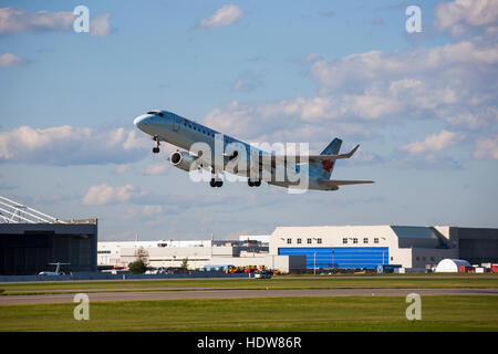 Embraer 190; Montreal, Quebec, Canada - Stock Photo