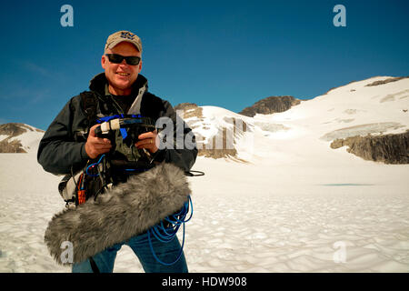 Paul Andrew Lawrence, Production Sound Mixer in Alaska working on a commercial shooting on top of a Glacier in South - Stock Photo